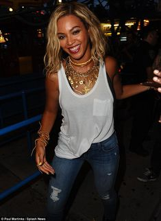 Who said work couldn't be fun: Beyonce couldn't wipe a smile off her face as she filmed her video
