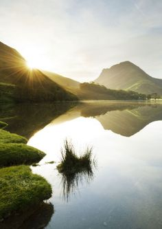 According to legend, Buttermere Lake in the English Lake District was the site of a hidden stronghold used by guerrillas fighting the Normans until the 1200s. 'The twin valleys of Buttermere and Borrowdale encapsulate the essence of the Lakeland landscape – a pastoral tapestry of green fields, cottages, rickety barns and rolling fells stitched together by mile upon mile of winding dry-stone walls' // photo by Justin Foulkes in our February '12 feature 'Perfect Trip: the Lake District'