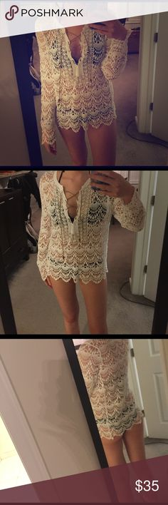 Crochet bathing suit coverup So pretty! Crochet material with a v neck that is laced up with beads at the bottom of the string. Bought for a girls weekend but never wore because I. Fought WAY to many coverups haha 😀 no flaws. Like new condition. I'm 5'8 for reference Swim Coverups