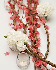 DIY Cherry Blossoms using branches and pink tissue paper blossoms. Excellent idea, especially if cherry blossoms are not in season.