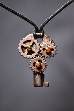 STEAMPUNK GODNESS! This is so bad ass.  OOAK multiple gear antique padlock key by RagsAndOldIron13 on Etsy