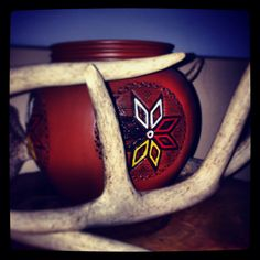 Mi'kmaq star. Pottery art from Lennox island. This is a centre piece on a side table surrounded by deer sheds found locally.