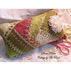 "I ❤ crazy quilting & embroidery . . .  Crazy Quilted Pincushion - Lemon & Raspberry Sherbet- 9.5"" x 5. It's a pincushion scented with lavender from Provence. It's all hand-sewn & hand-embroidered, made with 100% new cotton fabrics in shades of pink, green & cream........."