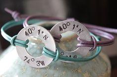 2 Aluminum Alloy Hand Stamped Latitude and Longitude Coordinates Washer with Leather Band Bracelets. $38.00, via Etsy.