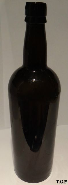 ANTIQUE BLACK GLASS VICTORIAN 1870's WHISKY,SPIRIT LIQUOR BOTTLE.W.A.GILBEY.