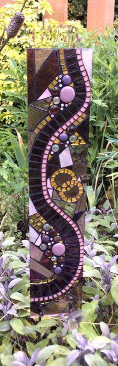Art for the garden by Jacquie Primrose. Personalised unique hand crafted wedding / anniversary gift, abstract glas mosaic sculpture, with interlocking gold wedding rings. www.primrosemosaics.com