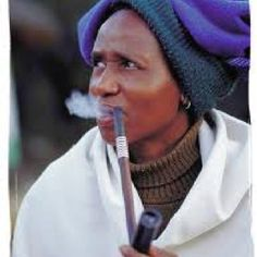 Xhosa lady enjoying her pipe at the lesedi cultural village -South Africa