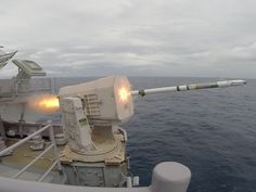 The amphibious assault ship USS Iwo Jima fires its Mk31 Rolling Airframe Missile Launcher. Boom.
