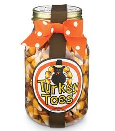 """Turkey Toes"" -- Candy corn in a jar with a cute label and ribbon.  What a fun gift idea for Thanksgiving!"