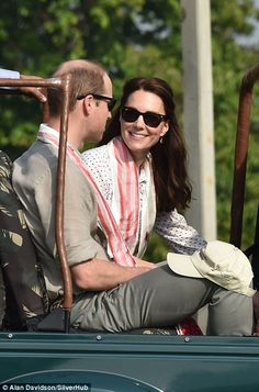 The king and queen of the jungle! Kate keeps it casual with Zara jeans, a spotted blouse and tied back hair while William opts for classic outfit of chinos and khakis as they head out on safari | Daily Mail Online