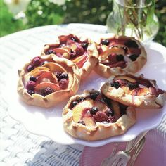 Jeweled Fruit Galettes | These free-form treats are sweetened to perfection with plums, peaches, blueberries, and cherries.