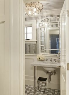 Design Manifest: Gorgeous Details for the Chic Bathroom. I love the lighting and the tile.