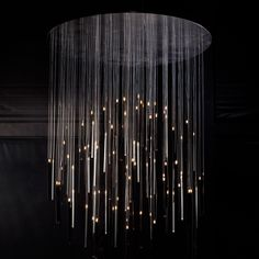 "Candle In the Wind, a chandelier of high-tech candles with LED ""flames,"" by Ingo Maurer and Moritz Waldemeyer. Cool Lighting, Modern Lighting, Lighting Design, Italian Lighting, Chandeliers, Chandelier Lighting, Metal Chandelier, Light Art, Lamp Light"