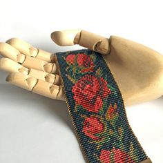The motive of this gorgeous loom beaded bracelet with roses is inspired from a french evening purse, 1825. Red roses on dark navy blue or black background at you choise. Wight: 45 mm (aprox.1,77 inch) Length: will be made to order. Just provide your wrist size at the checkout. This beadweaving
