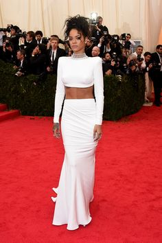 Vogue Daily — Rihanna in a Stella McCartney dress, Jacob & Co. necklace, Cartier rings, and Dionea Orcini rings