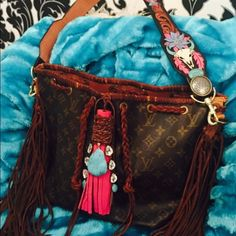 Authentic Louis Vuitton petit noe.  Ranch meets Regal with this CDK leather designed strap which is complimented by pink tassel, turquoise and rhinestones!