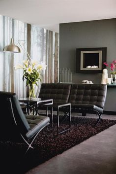 Moody black and grey living room.  Image from Hus & Hem.