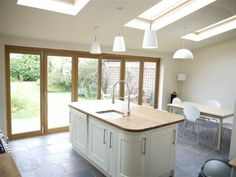 Pine frame roof windows adds a warm finish to this kitchen extension. And you could do your best Gordon Ramsay impression under the evening stars! Kitchen Family Rooms, Kitchen Living, New Kitchen, Kitchen Units, Kitchen Ideas, Kitchen Diner Extension, Open Plan Kitchen, Conservatory Kitchen, Conservatory Roof