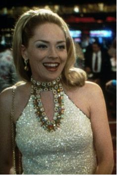 Sharon Stone won an Oscar for her role as Ginger, the devious wife of high rolling gambler, but it was her flashy, sequinned Las Vegas wardrobe that stole the show.  FACT: The costume budget for the film was $1 million, and Sharon had 40 costume changes. The white and gold dress pictured weighed a whopping 45 pounds.
