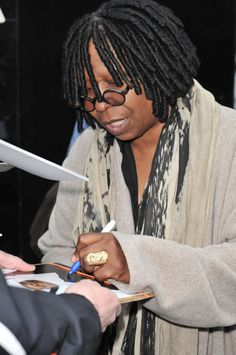Whoopie Goldberg with pen in left hand! Genius!