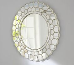 Circle Blossom Mirror #PotteryBarnKids-- for over her bed?  @Michael Dussert Zinna