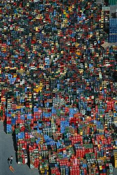 Bottle racks near Braunschweig, Germany - photo by Yann Arthus-Bertrand;  Not far from Braunschweig, in the north of Germany, an avalanche of mineral water, beer, fruit juice, and soda containers sprawls over a wholesaler's warehouse lot.