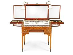 An early 20th century satinwood dressing table by Finnigans Ltd.