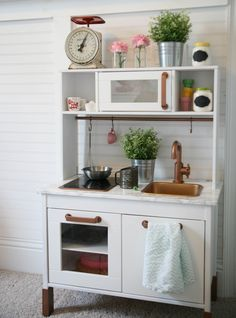 IKEA duktig play kitchen hack. I spray painted the kitchen white, the fixture, sink & hardware copper & applied marble contact paper over the existing countertop. total cost $25.