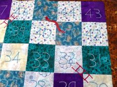 The snakes and ladders quilt is simple to make with satin stitch ladders and applique snakes. Can be a quilt or a playmat.