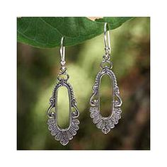 @Overstock - Sterling Silver 'Good Fortune' Dangle Earrings (Thailand) - These elegant earrings from Wadarat Supasirisuk are designed to bring good luck. At the bottom of the earrings' hollow oval, the Thai number nine can be seen; its name � gao � sounds much like khao (rice) and kow-nah (progress).  http://www.overstock.com/Worldstock-Fair-Trade/Sterling-Silver-Good-Fortune-Dangle-Earrings-Thailand/5836263/product.html?CID=214117 $24.99