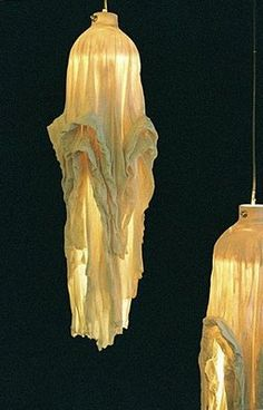 fabric dipped in slip and fired. lamps