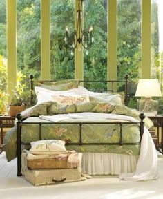 An iron bed is a sure-fire way to establish a classic look in a bedroom, which leaves room for lots of personal expression. Here, the unexpected palette of tart green walls and bedding echo the abundant foliage just beyond the windows, and create a look that's as exuberant and restful as the great outdoors. A fluffy duvet and a good bedside lamp form a sweet nook for reading and relaxing.  Benjamin Moore™ Paint Color:  2147-30 jalepeno pepper