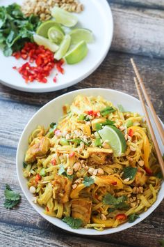 Tofu Curry Noodles with Vegetables - perfect for Meatless Monday, these rice noodles are swimming in a peanut-curry sauce that is totally KILLER!
