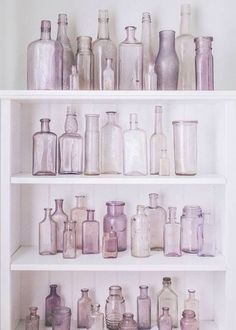 Vintage bottles in a variety of lavender hues