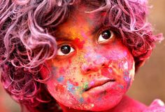 An Indian child, face smeared with colored powder, celebrates Holi festival in Mumbai, India, Wednesday, March. 27, 2013. Holi, the Hindu festival of colors that also marks the advent of spring, is being celebrated across the country Wednesday.(AP Photo/Rajanish Kakade)