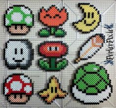 Here are some Mario themed perlers! The perlers are as follows. ~1-UP Mushroom ~Fire Flower ~Moon ~Cloud ~Fire Flower 2 ~Feather ~Super Mushroom ~Banana ~Koopa Shell