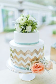 Eclectic wedding cake with chevron: http://theeverylastdetail.com/eclectic-navy-mint-peach-wedding-ideas/