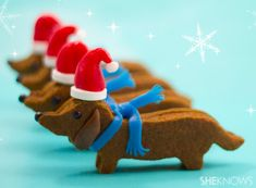 Wiener Dog Cookies by sheknows: Simple molasses sugar cookies sandwiches together with frosting and topped with an edible candy hat and scarf! #Cookies #Dachshund