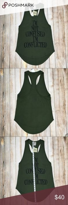 "Haute Hippie Conflicted tank ""I'm not confused I'm conflicted"" tank by Haute Hippie. Aren't we all?!? NWT, no flaws, easy and loose fit, very soft. Approximate measurements provided in pics.   Tags: racerback, army green, festival, weekend, casual, comfortable, graphic tank, graphic tee, printed, print, olive green Haute Hippie Tops Tank Tops"