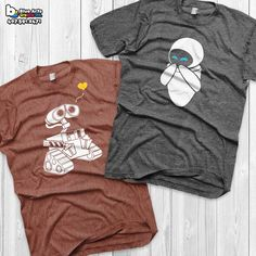 Check out my shop for more: https://www.etsy.com/shop/BlueArtsGraphix Feel free to message me with custom requests. Thanks! *BROWN/ Wall-e *GRAY/ Eve WALL-E and EVE T-shirt - Get yours Today! - Printed in the USA, Florida *Machine wash warm,inside out with like colors. Only