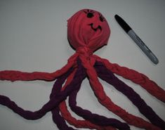 Free pattern for how to Make an Octopus Ball Toy for Your Dog using a tennis ball and old t-shirts.