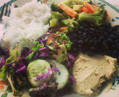 Lunch! Salad, rice, beans, hummus, creamy garlic veggies