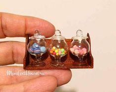 Miniature sweets on the wood shelf