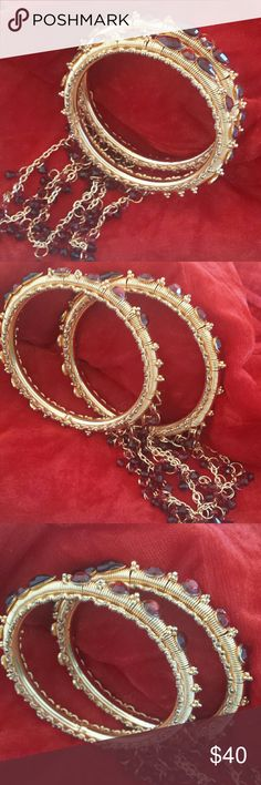 Authentic Indian Jewelry Gold with Red stones and loose fancy chains hanging. Wore a few times for special occasions. Jewelry Bracelets