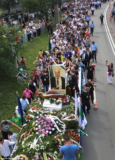 March of the Roma: Thousands of Romani gypsies followed the truck heading for the cemetery to honour their leader