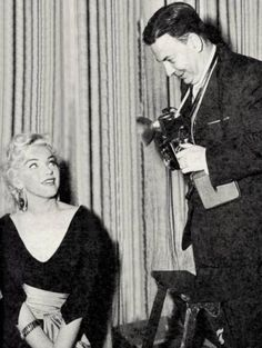 "Marilyn with journalist Earl Wilson during the filming of ""There's No Business Like Show Business"", 1954."