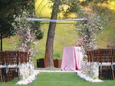 Flowering dogwood or cherry blossom branches as the basis of the ceremony arch