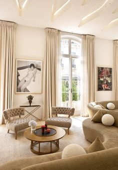 Pierre Yovanovitch's very stylish living room at home with Vladimir Kagan sofas and Billy Haines arm chairs.