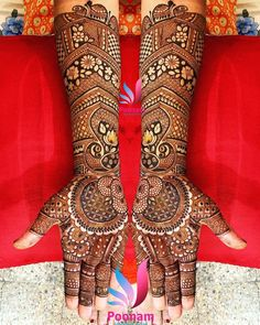 This traditional and symmetrical full hand mehndi design is proof that traditionalism never gets outdated. Adorned with multiple mandalas and flower patterns.