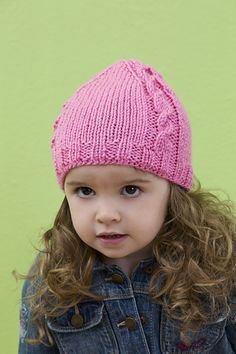 For the fashionable little girl, here's a hat that is perfectly designed for warmth and classic style. Knit it in boyish colors for the little men in your life.